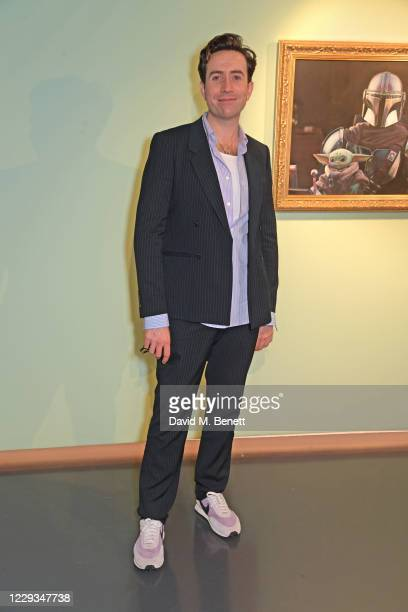 """Nick Grimshaw attends a private view of """"The Mandalorian And The Child"""", a special portrait being unveiled in collaboration with the National..."""