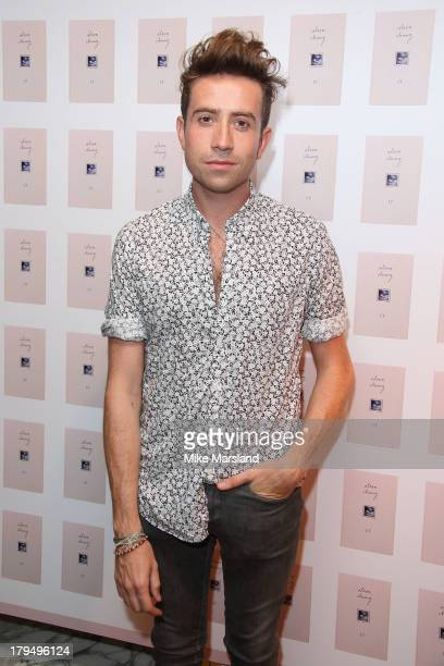 Nick Grimshaw attends as Alexa Chung celebrates the launch of her first book It at Liberty on September 4 2013 in London England