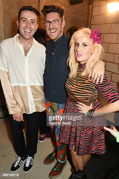 Nick Grimshaw designer Henry Holland and Aimee Phillips attend the House Of Holland show during London Fashion Week SS16 at Collins Music Hall on...