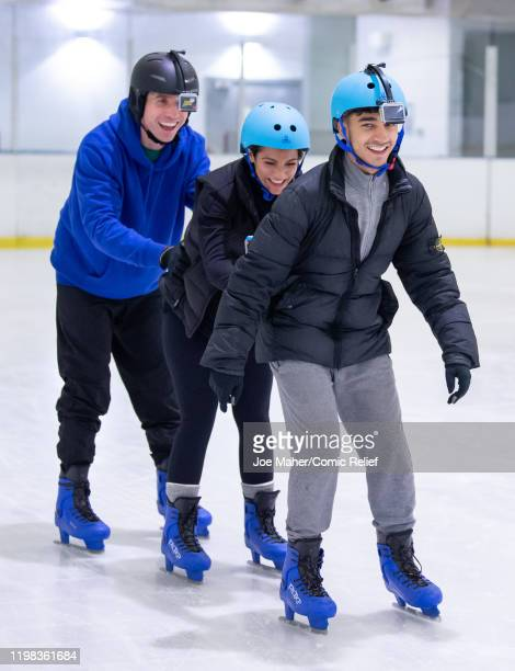 Nick Grimshaw Frankie Bridge and Karim Zeroual train on an ice rink for Sport Relief On Thin Ice as the celebrities prepare to cycle skate and trek...