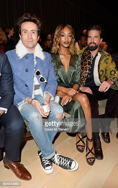 Nick Grimshaw Jourdan Dunn and Jack Guinness attend the Burberry Menswear January 2016 Show on January 11 2016 in London United Kingdom