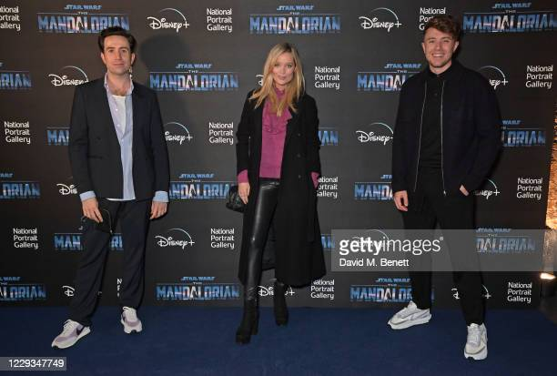 """Nick Grimshaw, Laura Whitmore and Roman Kemp attend a private view of """"The Mandalorian And The Child"""", a special portrait being unveiled in..."""