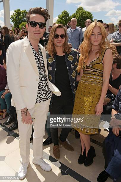 Nick Grimshaw Oscar Tuttiett and Clara Paget attend the front row at Burberry Menswear Spring/Summer 2016 show at Kensington Gardens on June 15 2015...