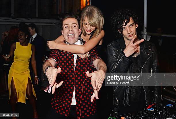 Nick Grimshaw Taylor Swift and Matt Healy attends the Universal Music Brits party hosted by Bacardi at The Soho House PopUp on February 25 2015 in...