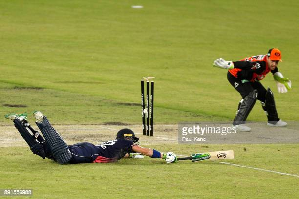 Nick Gubbins of the Lions is runout by Josh Inglis of the Scorchers during the Twenty20 match between the Perth Scorchers and England Lions at Optus...