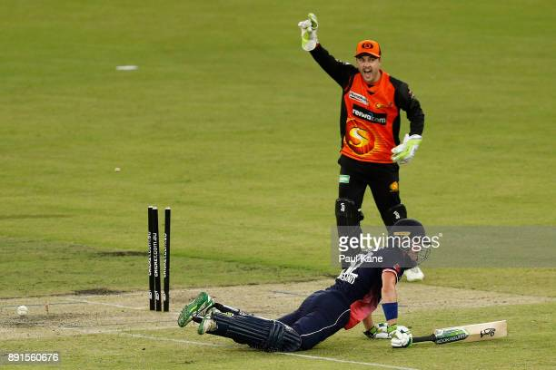 Nick Gubbins of the Lions looks to the square leg umpire after being runout by Josh Inglis of the Scorchers during the Twenty20 match between the...