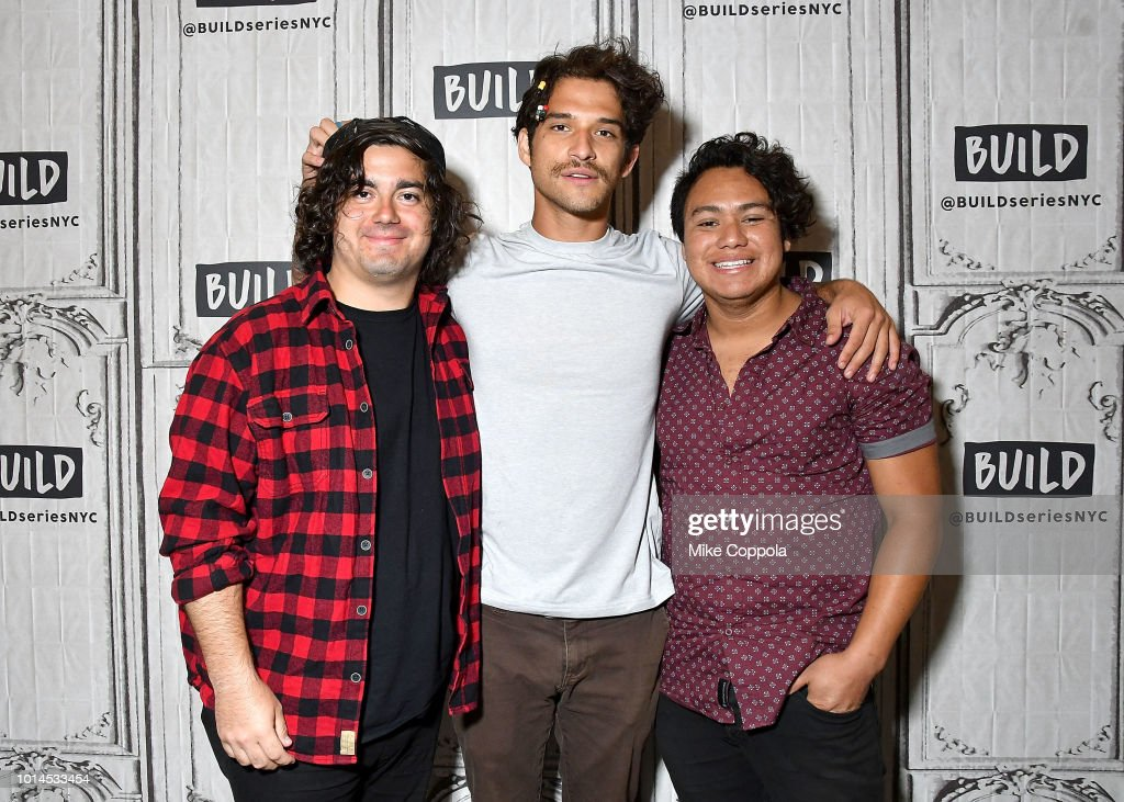 Nick Guzman, Tyler Posey, and Freddy Ramirez of the band PVMNTS pose for a photo during their visit to Build Studio on August 10, 2018 in New York City.