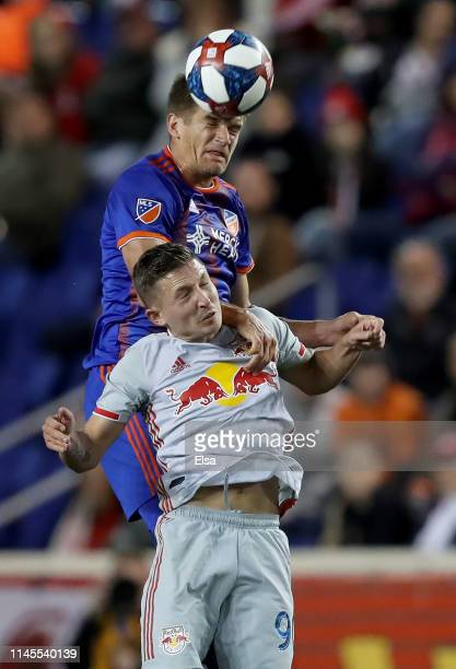 Nick Hagglund of FC Cincinnati and Marc Rzatkowski of New York Red Bulls fighrt for the ball in the second half at Red Bull Arena on April 27, 2019...