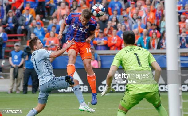Nick Hagglund of FC Cincinnati heads the ball into the goal against Kelyn Rowe of Sporting Kansas City at Nippert Stadium on April 7 2019 in...