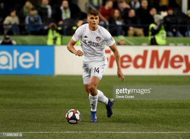 Nick Hagglund of FC Cincinnati kicks the ball during the first half of the match against the Seattle Sounders at CenturyLink Field on March 2, 2019...