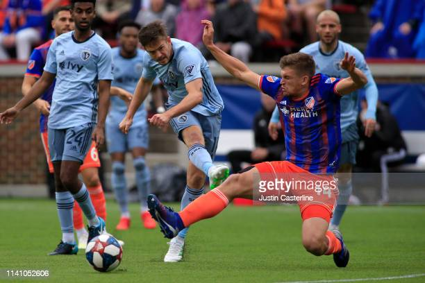 Nick Hagglund of the Cincinnati FC blocks a kick from Adrian Zendejas of the Sporting Kansas City during the first half at Nippert Stadium on April...