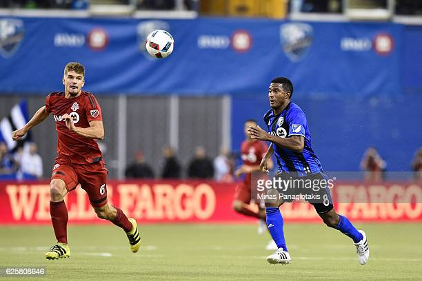 Nick Hagglund of the Toronto FC and Patrice Bernier of the Montreal Impact run after the ball during leg one of the MLS Eastern Conference finals at...
