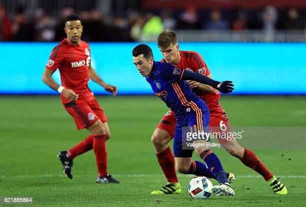 Nick Hagglund of Toronto FC battles for the ball with Jack Harrison of New York City FC during the second half of an MLS Conference semifinal playoff...
