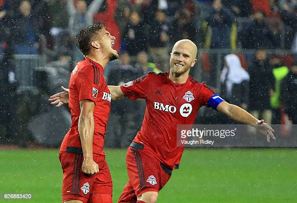 Nick Hagglund of Toronto FC celebrates a goal with Michael Bradley during the second half of the MLS Eastern Conference Final Leg 2 game against...