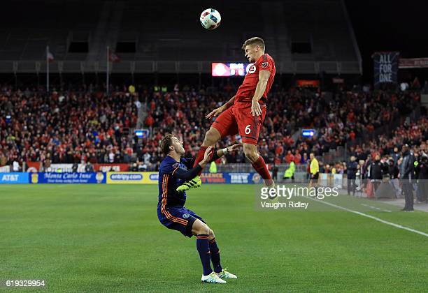 Nick Hagglund of Toronto FC goes up for a header as RJ Allen of New York City FC defends during the first half of an MLS Conference semifinal playoff...