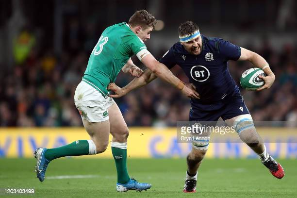 Nick Haining of Scotland pushes off Garry Ringrose of Ireland during the 2020 Guinness Six Nations match between Ireland and Scotland at Aviva...