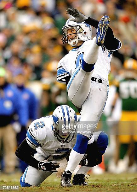 Nick Harrris of the Detroit Lions holds as Jason Hanson kicks a field goal against the Green Bay Packers at Lambeau Field December 17, 2006 in Green...