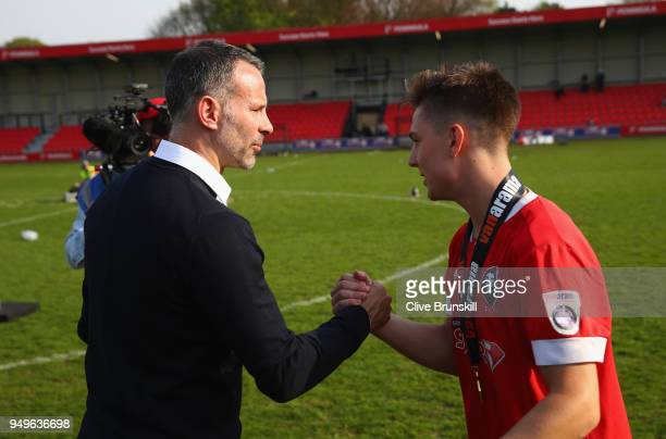 Nick Haughton of Salford City is congratulated by Ryan Giggs co owner of Salford City prior to the official group photo after Salford win the...
