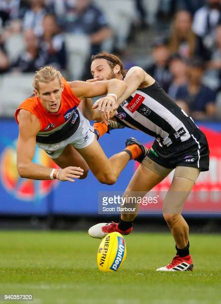 Nick Haynes of the Giants and James Aish of the Magpies compete for the ball during the round two AFL match between the Collingwood Magpies and the...