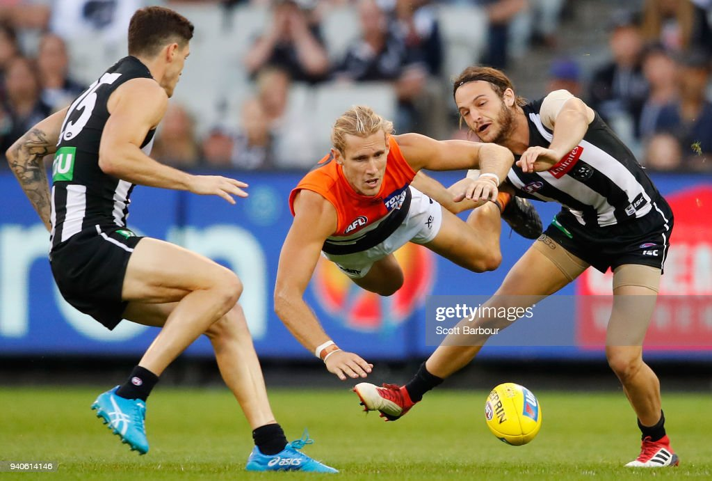Nick Haynes of the Giants and James Aish of the Magpies compete for the ball during the round two AFL match between the Collingwood Magpies and the Greater Western Sydney Giants at Melbourne Cricket Ground on March 31, 2018 in Melbourne, Australia.