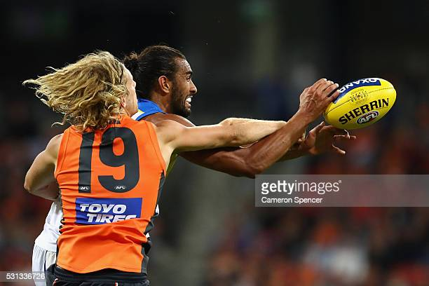 Nick Haynes of the Giants and Tom Nicholls of the Suns contest the ball during the round eight AFL match between the Greater Western Sydney Giants...