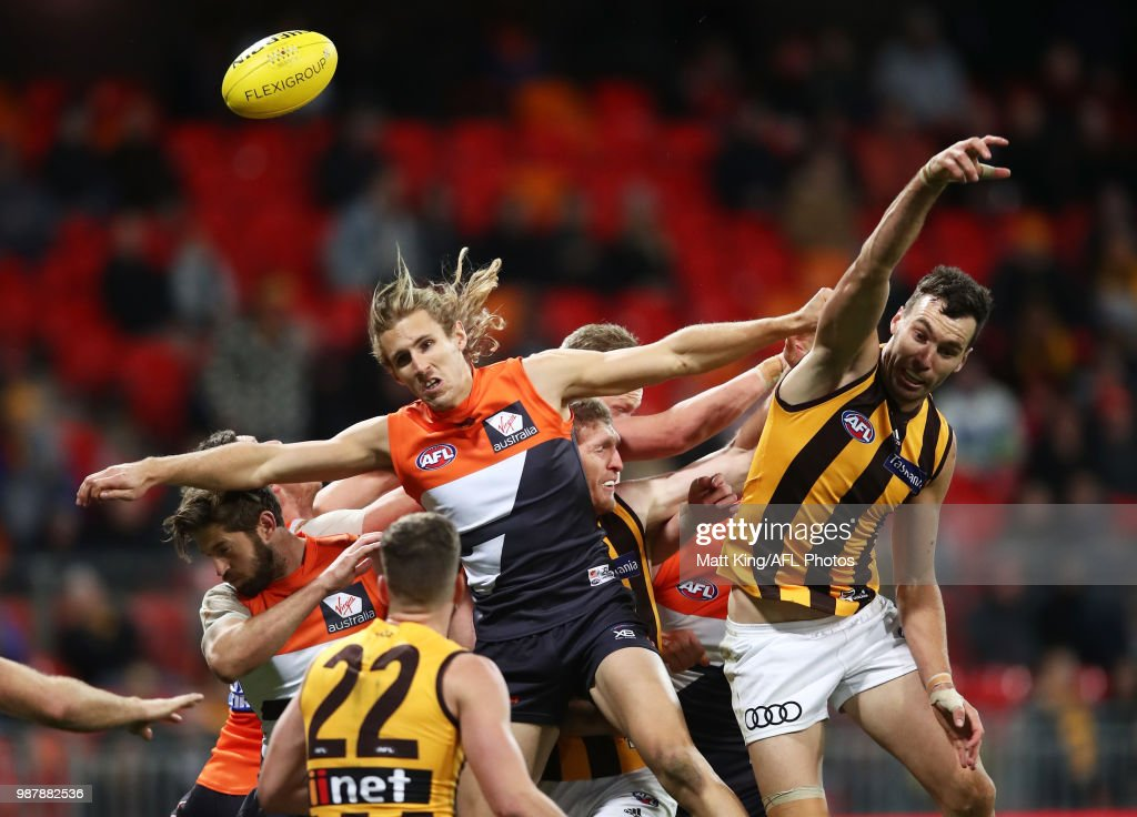 Nick Haynes of the Giants competes for the ball against Jonathon Ceglar of the Hawks during the round 15 AFL match between the Greater Western Sydney Giants and the Hawthorn Hawks at Spotless Stadium on June 30, 2018 in Sydney, Australia.