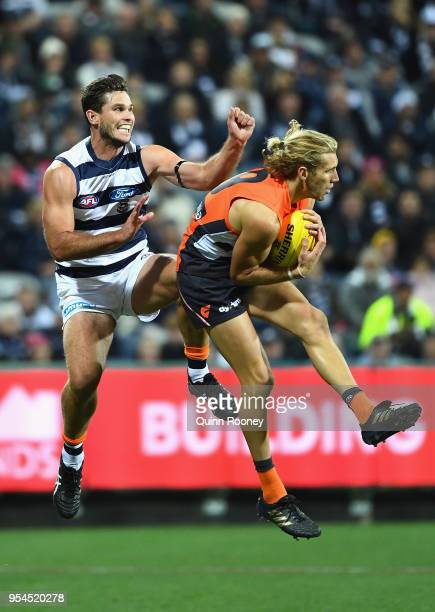 Nick Haynes of the Giants marks infront of Tom Hawkins of the Cats during the round seven AFL match between the Geelong Cats and the Greater Western...