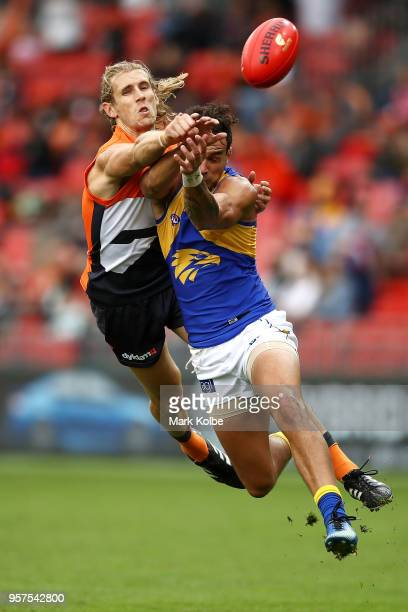 Nick Haynes of the Giants spoils the attempt from Brendan Ah Chee of the Eagles during the round eight AFL match between the Greater Western Giants...