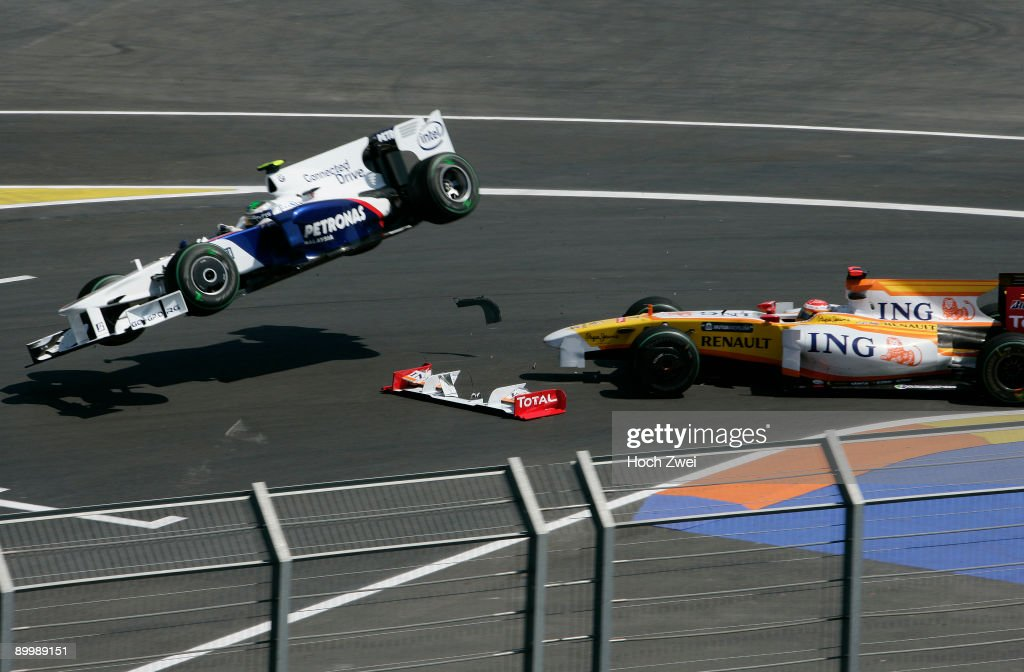 Nick Heidfeld (L) of Germany and BMW Sauber collides with Fernando Alonso (R) of Spain and Renault during practice for the European Formula One Grand Prix at the Valencia Street Circuit on August 21, 2009, in Valencia, Spain.