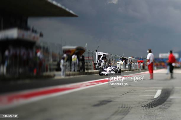 Nick Heidfeld of Germany and BMW Sauber drives down the pitlane during the warm up session prior to qualifying for the Turkish Formula One Grand Prix...