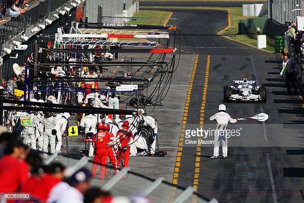 Nick Heidfeld of Germany and BMW Sauber enters pitlane during the Australian Formula One Grand Prix at the Albert Park Circuit on March 16, 2008 in...