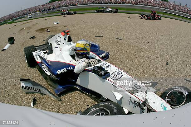 Nick Heidfeld of Germany and BMW Sauber gets out of his car after crashing on the first lap of the Formula One United States Grand Prix at...
