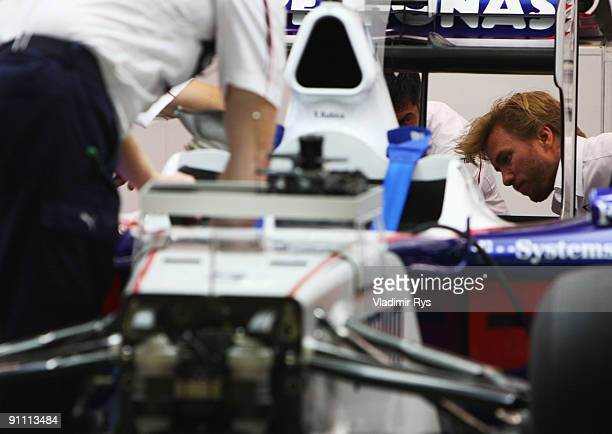 Nick Heidfeld of Germany and BMW Sauber is seen in his team garage during previews to the Singapore Formula One Grand Prix at the Marina Bay Street...