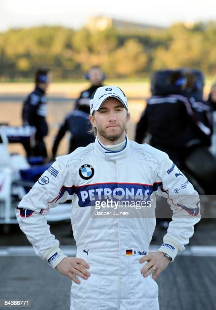 Nick Heidfeld of Germany and BMW Sauber poses for photographers after unveiling the new BMW Sauber F1.09 formula one car at the Ricardo Tormo...