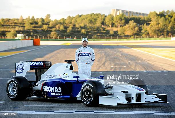 Nick Heidfeld of Germany and BMW Sauber poses with the new BMW Sauber F1.09 formula one car at the Ricardo Tormo racetrack on january 20, 2009 in...