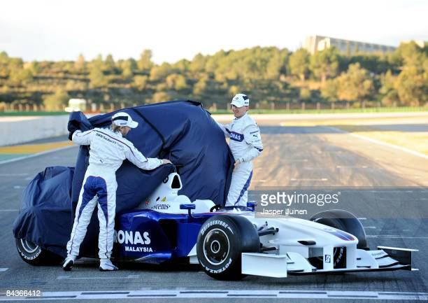 Nick Heidfeld of Germany and BMW Sauber unveils the new BMW Sauber F1.09 formula one car with his teammate Robert Kubica of Poland at the Ricardo...