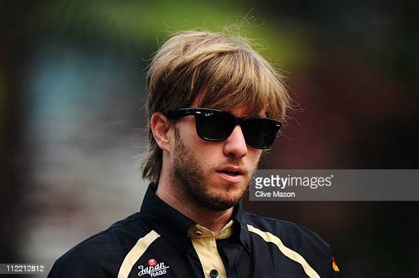 Nick Heidfeld of Germany and Renault arrives in the paddock before practice for the Chinese Formula One Grand Prix at the Shanghai International...
