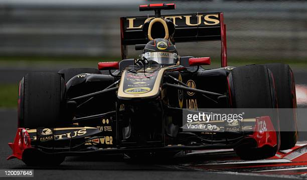 Nick Heidfeld of Germany and Renault drives during qualifying for the Hungarian Formula One Grand Prix at the Hungaroring on July 30, 2011 in...