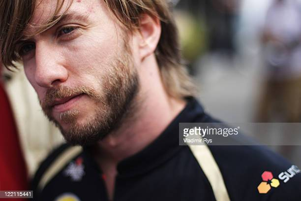 Nick Heidfeld of Germany and Renault is interviewed in the paddock by the media during previews to the Belgian Formula One Grand Prix at the Circuit...