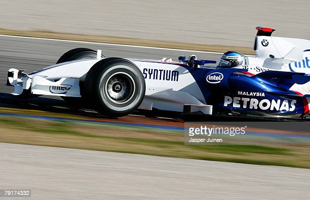 Nick Heidfeld of Germany and team BMW Sauber rounds a corner during Formula one testing at the Ricardo Tormo racetrack on January 23 in Cheste near...