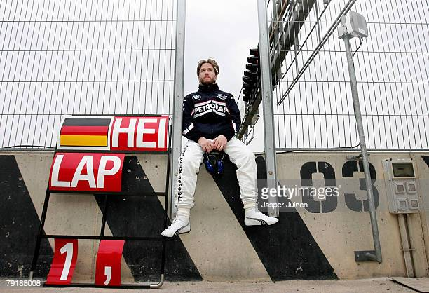 Nick Heidfeld of Germany and team BMW Sauber sits on the pit wall posing for a picture in between Formula one test session at the Ricardo Tormo...