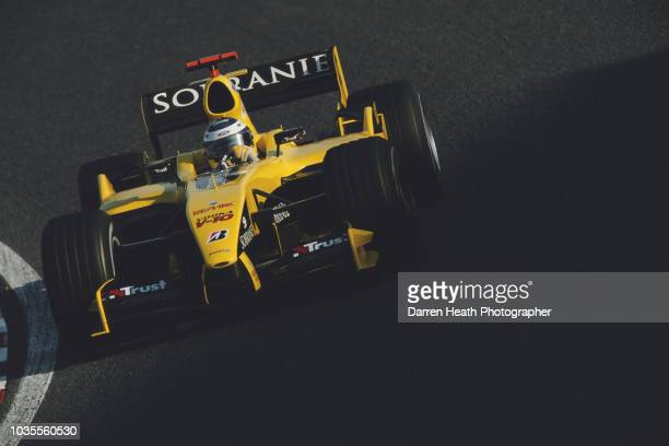 Nick Heidfeld of Germany drives the Jordan Ford Jordan EJ14 Ford RS2 V10 during the Formula One Japanese Grand Prix on 10 October 2004 at the Suzuka...