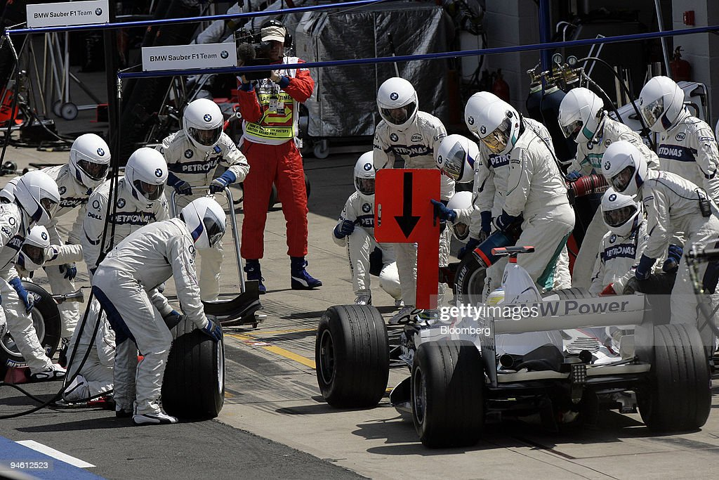 Nick Heidfeld, of Team BMW Sauber is seen making a pit stop : News Photo