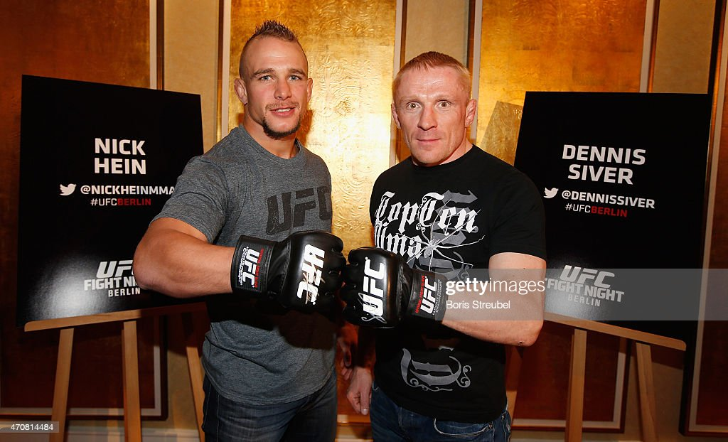 Nick Hein (L) of Germany and Dennis Siver of Russia pose during the UFC press conference at O2 World on April 23, 2015 in Berlin, Germany.