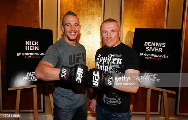 Nick Hein of Germany and Dennis Siver of Russia pose during the UFC press conference at O2 World on April 23 2015 in Berlin Germany