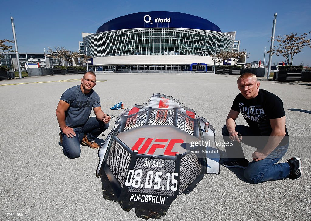 Nick Hein (L) of Germany and Dennis Siver of Russia pose in front of a Grafitti artwork after the UFC press conference at O2 World on April 23, 2015 in Berlin, Germany.