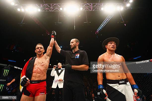 Nick Hein of Germany celebrates his submission victory over Tae Hyun Bang of South Korea in their Lightweight Bout during the UFC Fight Night held at...