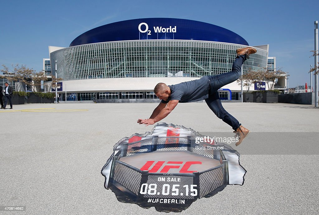 Nick Hein of Germany jumps in the oktagon of a Grafitti artwork after the UFC press conference at O2 World on April 23, 2015 in Berlin, Germany.