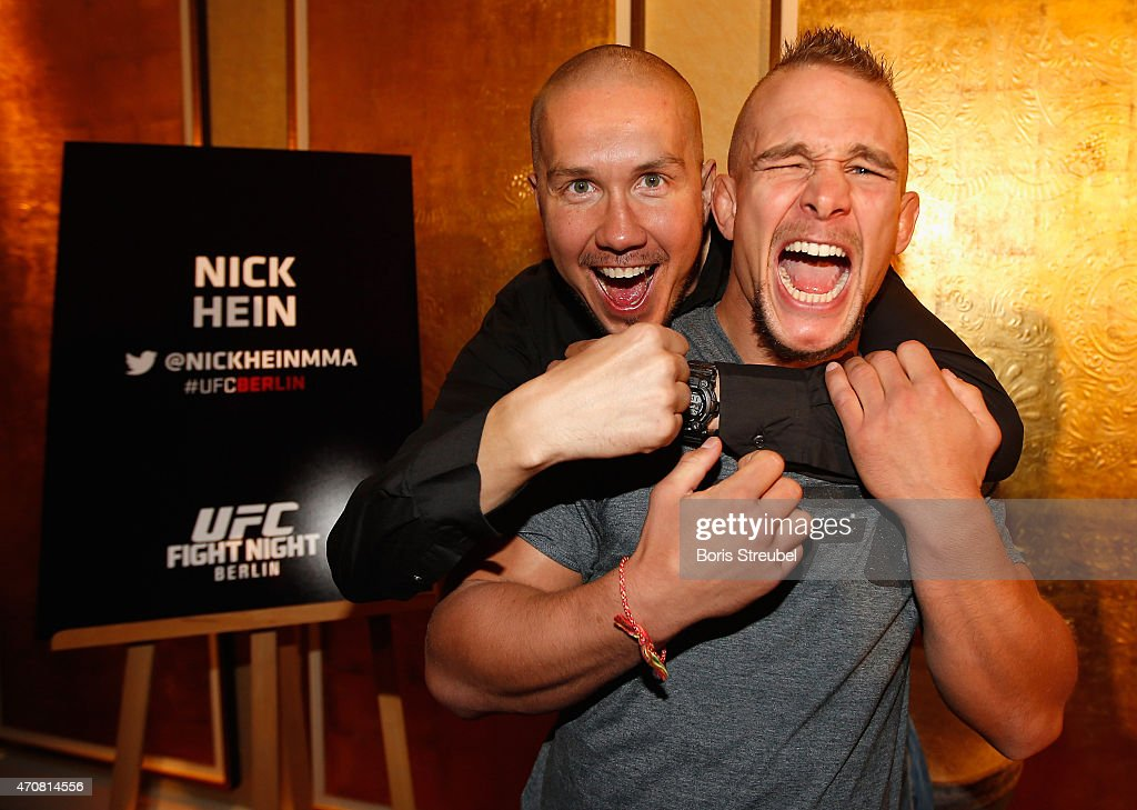 Nick Hein (R) of Germany poses with DJ Tommek during the UFC press conference at O2 World on April 23, 2015 in Berlin, Germany.