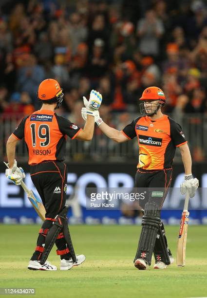 Nick Hobson of the Scorchers acknowledges Shaun Marsh at the conclusion of the innings during the Big Bash League match between the Perth Scorchers...